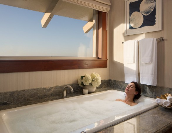 woman relaxing in the jacuzzi tub in the presidential suite