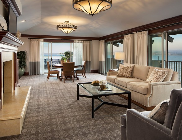 presidential suite with floor to ceiling windows overlooking the ocean