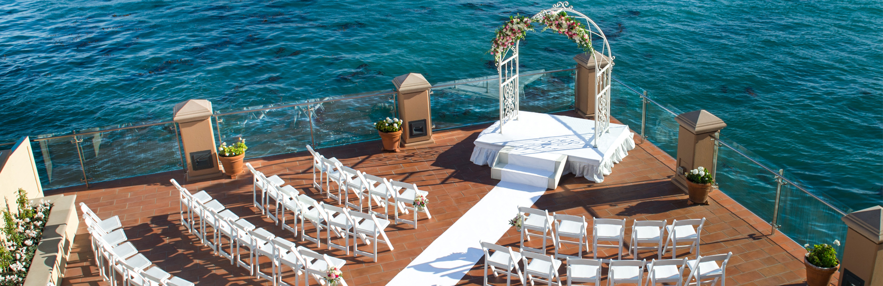 wedding ceremony set up on the oceanfront terrace