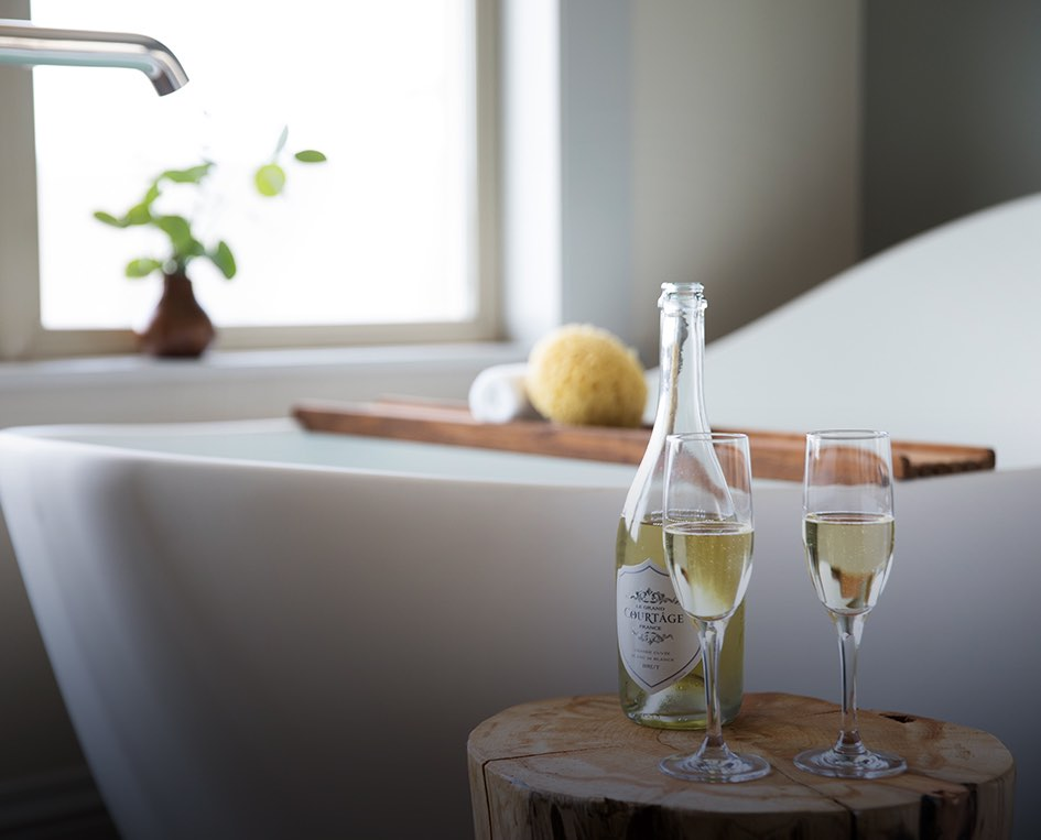 glasses of champagne by a spa tub