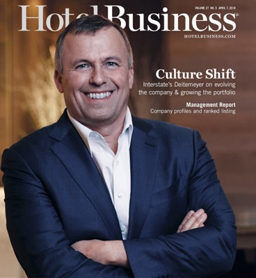 Man wearing blue suit on the cover of Hotel Business magazine
