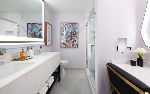 Guest bathroom with white porcelain sink and lighted mirror