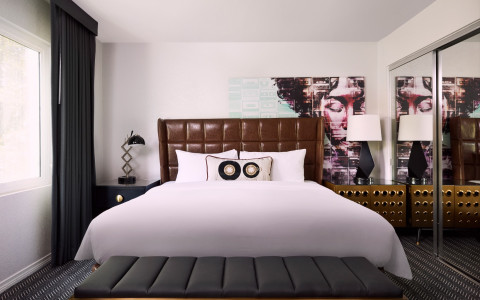 Guest Room with white linens and leather headboard