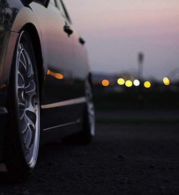 Close up of the tires on a car at sunset