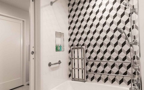accessible shower with bench and grab rails