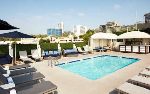 rooftop pool with cabanas and bar
