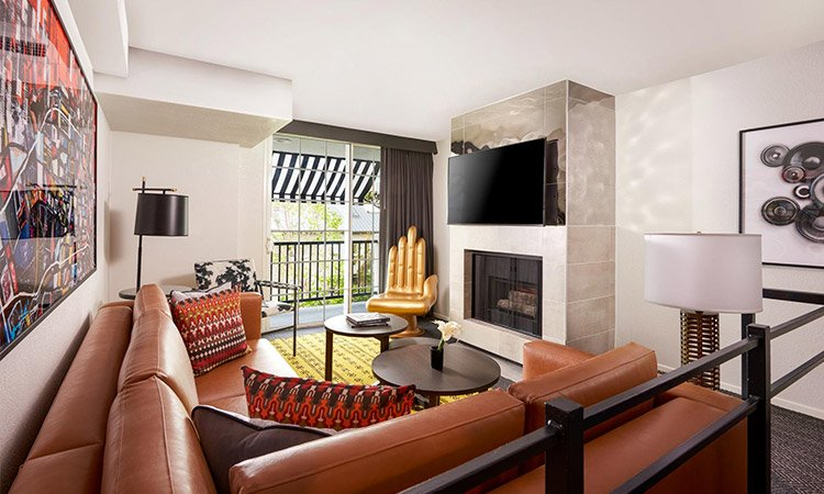guest room living area with fireplace and leather sofa