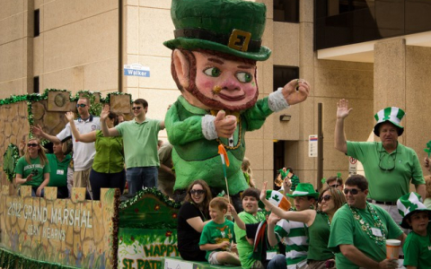 St Patricks Day Parade Float with waving people and giant leprechaun