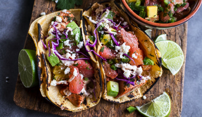authentic Mexican tacos with lime wedges and side of salsa
