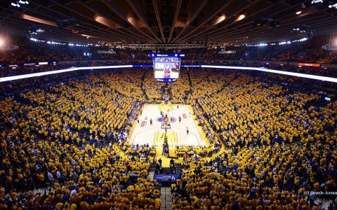 golden state warriors basketball game. The stadium in full with fans in teams golden yellow