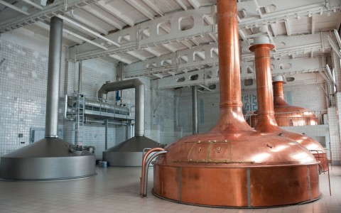 brewing production. large room with giant metal distillers