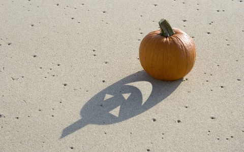 Plain pumpkin with a jack'o lantern shadow