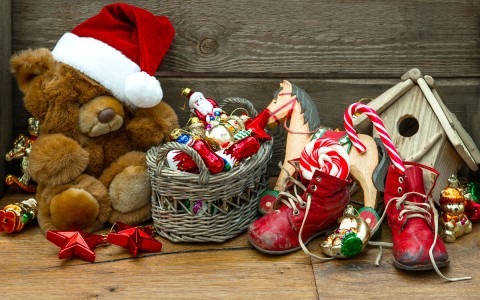 Christmas decor and toys piled on the floor