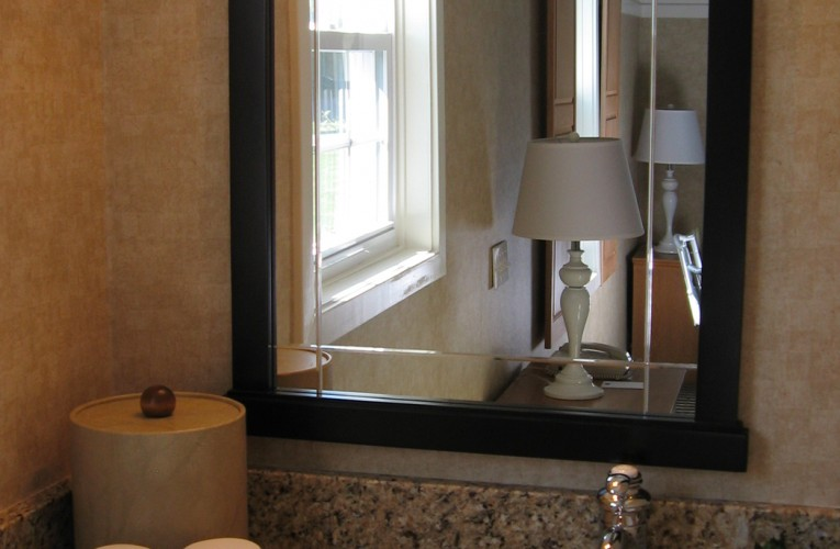 Vanity with reflection of hotel room