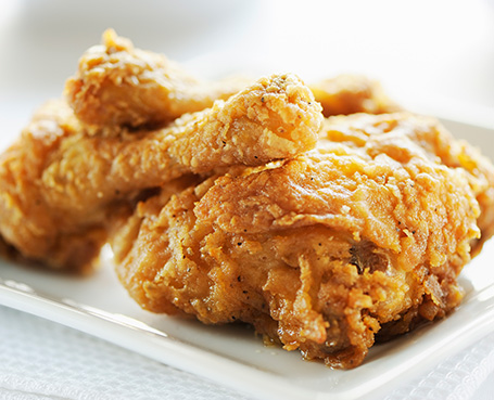 Crispy fried chicken on a white plate Image
