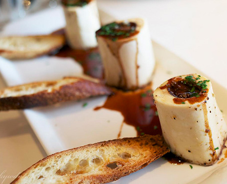 Bone marrow and bread on a white plate Image