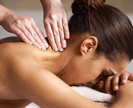 women receiving a neck massage Image