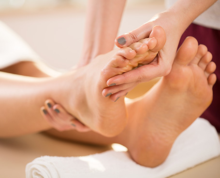 women receiving a foot rub Image