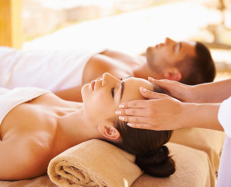 man and women receiving a couples massage Image
