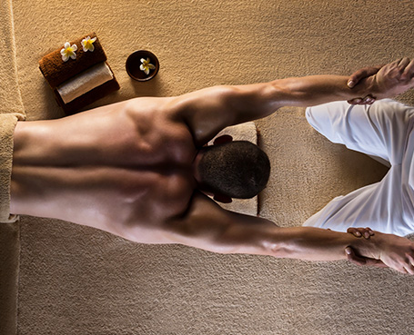 Man stretching in spa Image