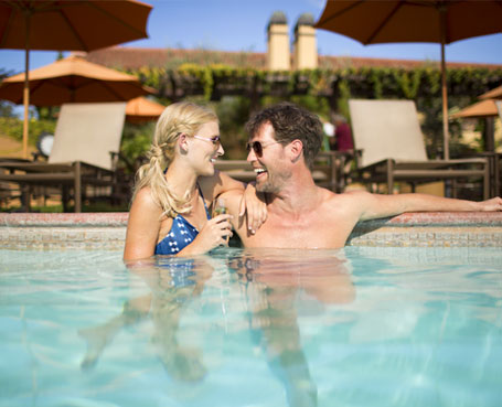 couple laughing in hotel pool