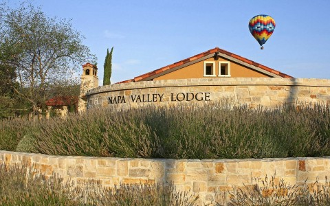 entryway to the  with Napa Valley Lodge with lodge name etched on stone wall