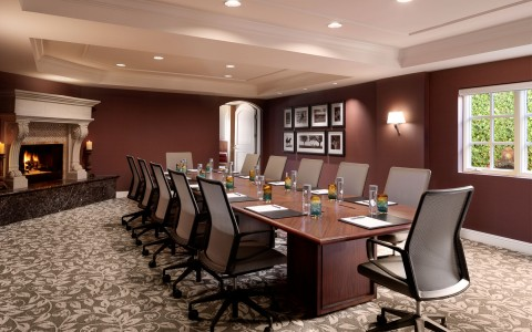 meeting room with conference table and fireplace in background