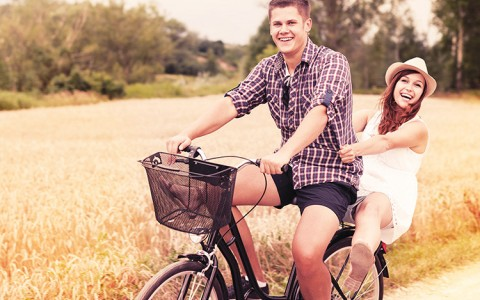 couple sharing a bicycle