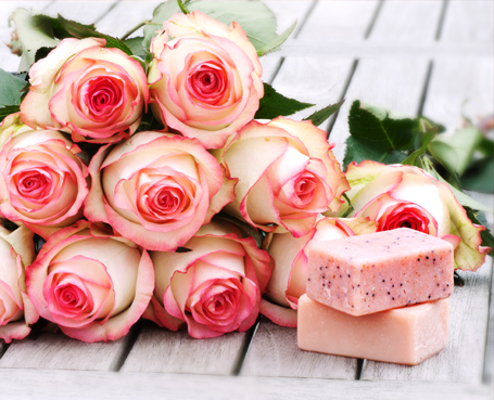 bunch of pink roses and two bars of pink soap Image