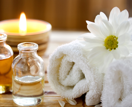 towels oil and flowers Image