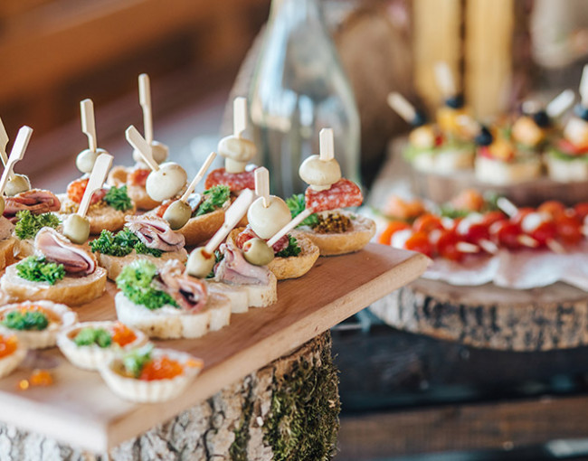 a table of hors d'oeuvres on wooden platters