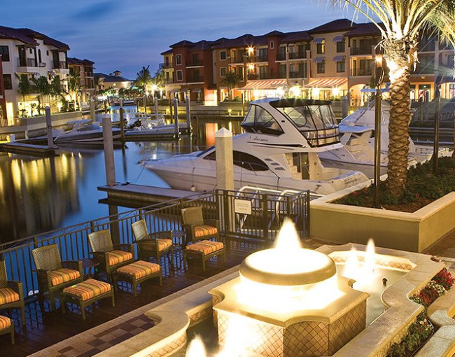 outdoor patio area with a water-fountain next to the marina