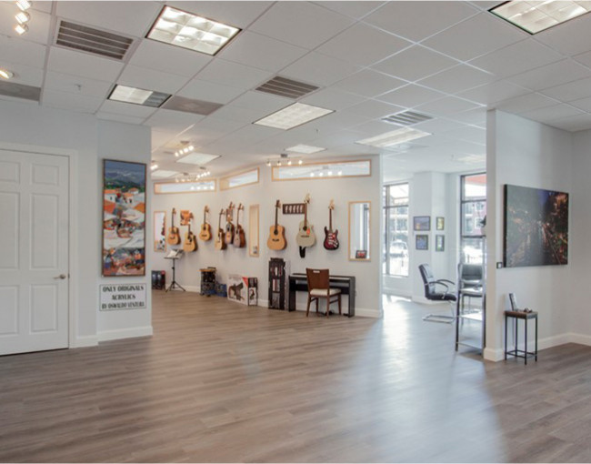 large activity space with guitars hanging on the wall