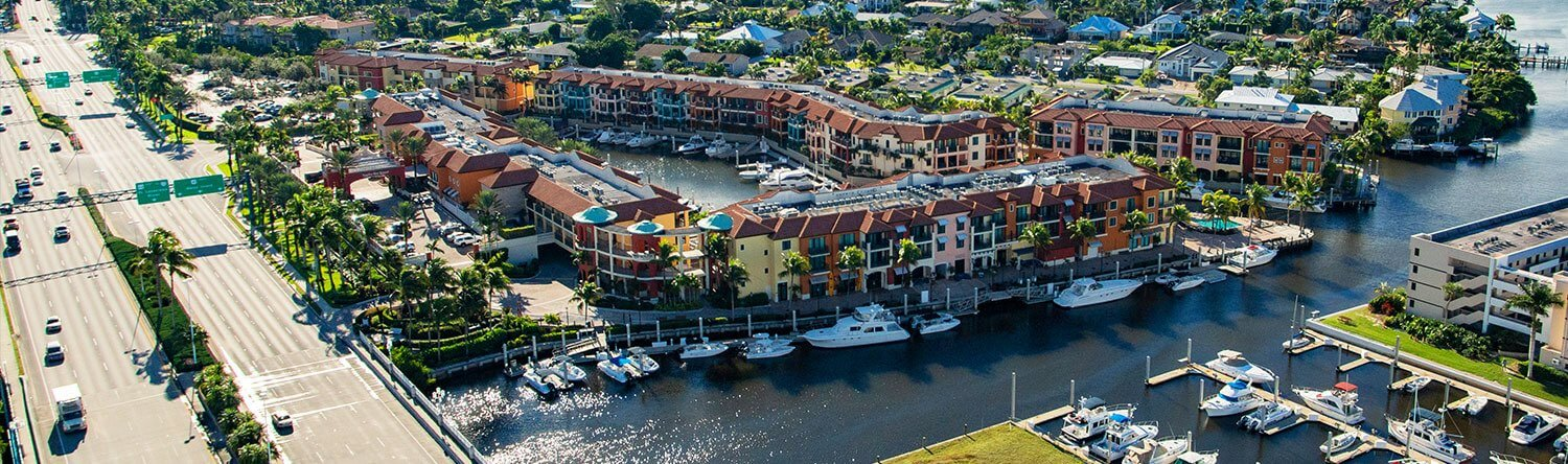 aerial image of the naples bay resort buildings along the water