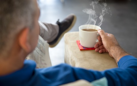 Man Sitting on Chair Drinking Coffee