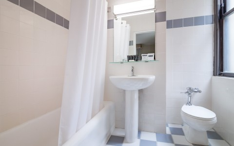 White Standard Bathroom with Bathtub, Toilet, and Sink