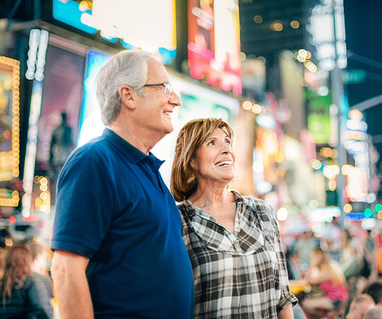 elderly couple in times square