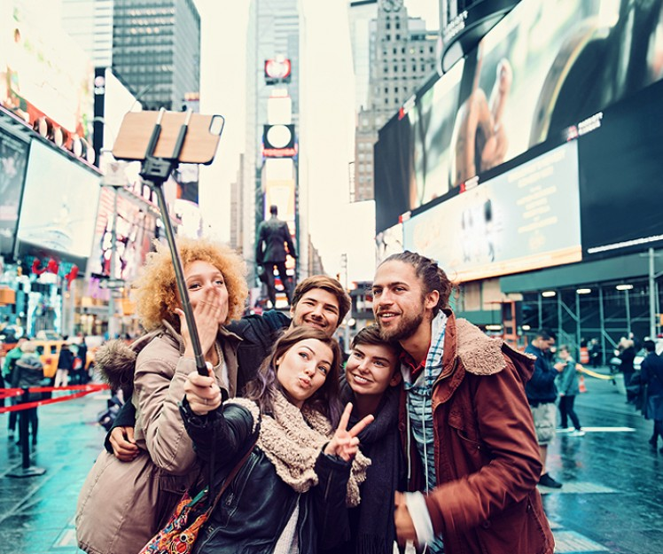 friends taking selfie at times square