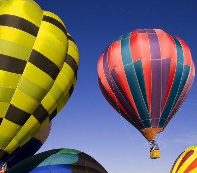Brightly Colored Hot Air Balloons Float Over Park City Utah
