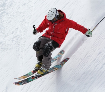 Downhill Skiier in Red Parka