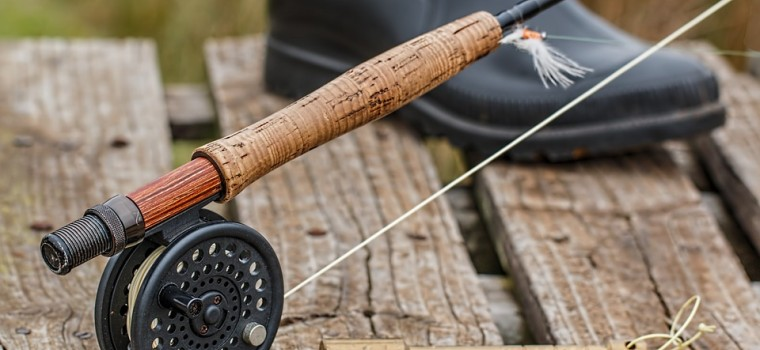 fishing rod on a wood dock