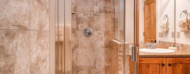 bathroom with  glass shower door