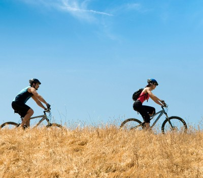 two people mountain biking