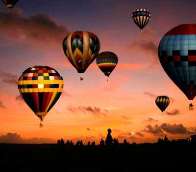 hot air balloons at sunset