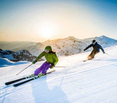 two people skiing down a mountain