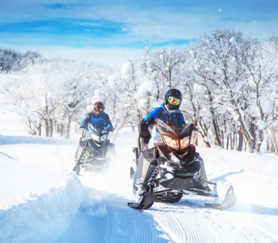 two men on snow mobiles