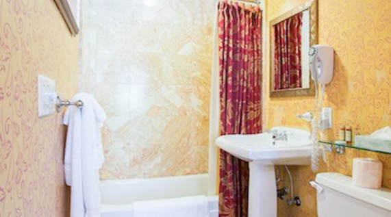 A queen deluxe guest bathroom