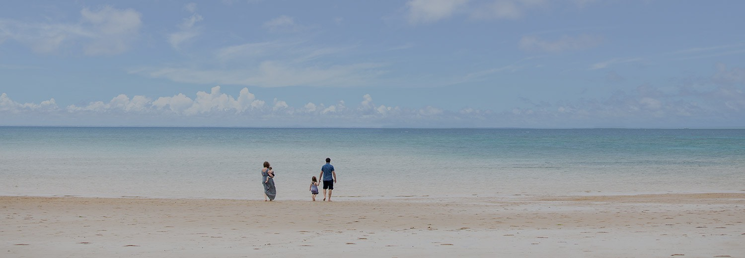 a family playing on the beach