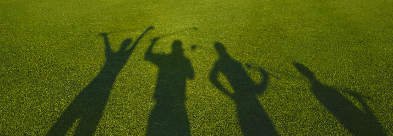 shadows of people playing golf