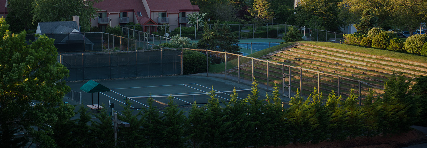 overview of tennis courts at resort property